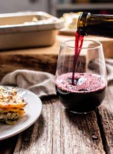 White Veggie Lasagna slice with wine